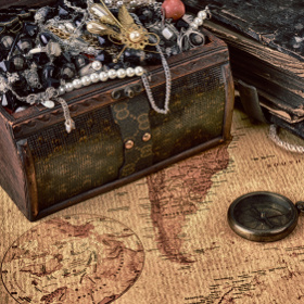 Wooden treasure chest with valuables. beads, necklaces and other jewelry
