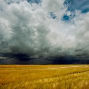 Storm dark clouds over field
